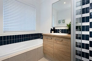 Move Over Black Say Hello To Navy Bathroom by GO Homes